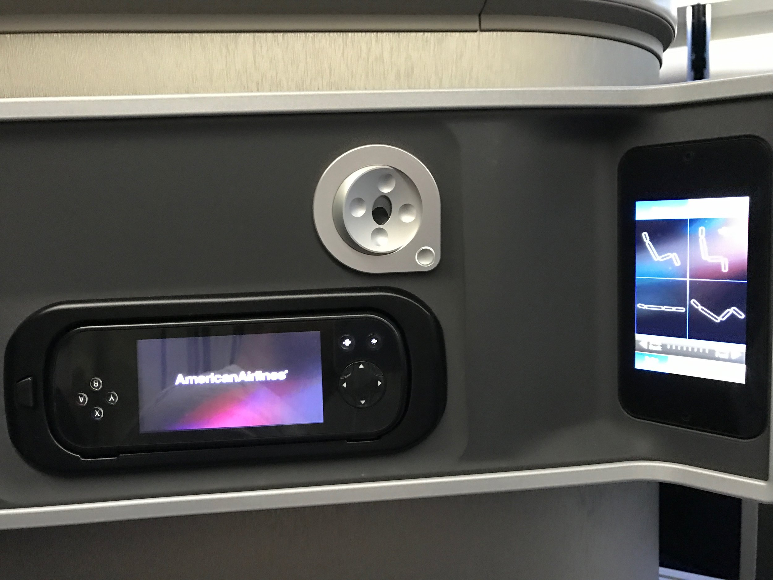 AA 787 Dreamliner Business Class IFE handset, reading light, and seat controls
