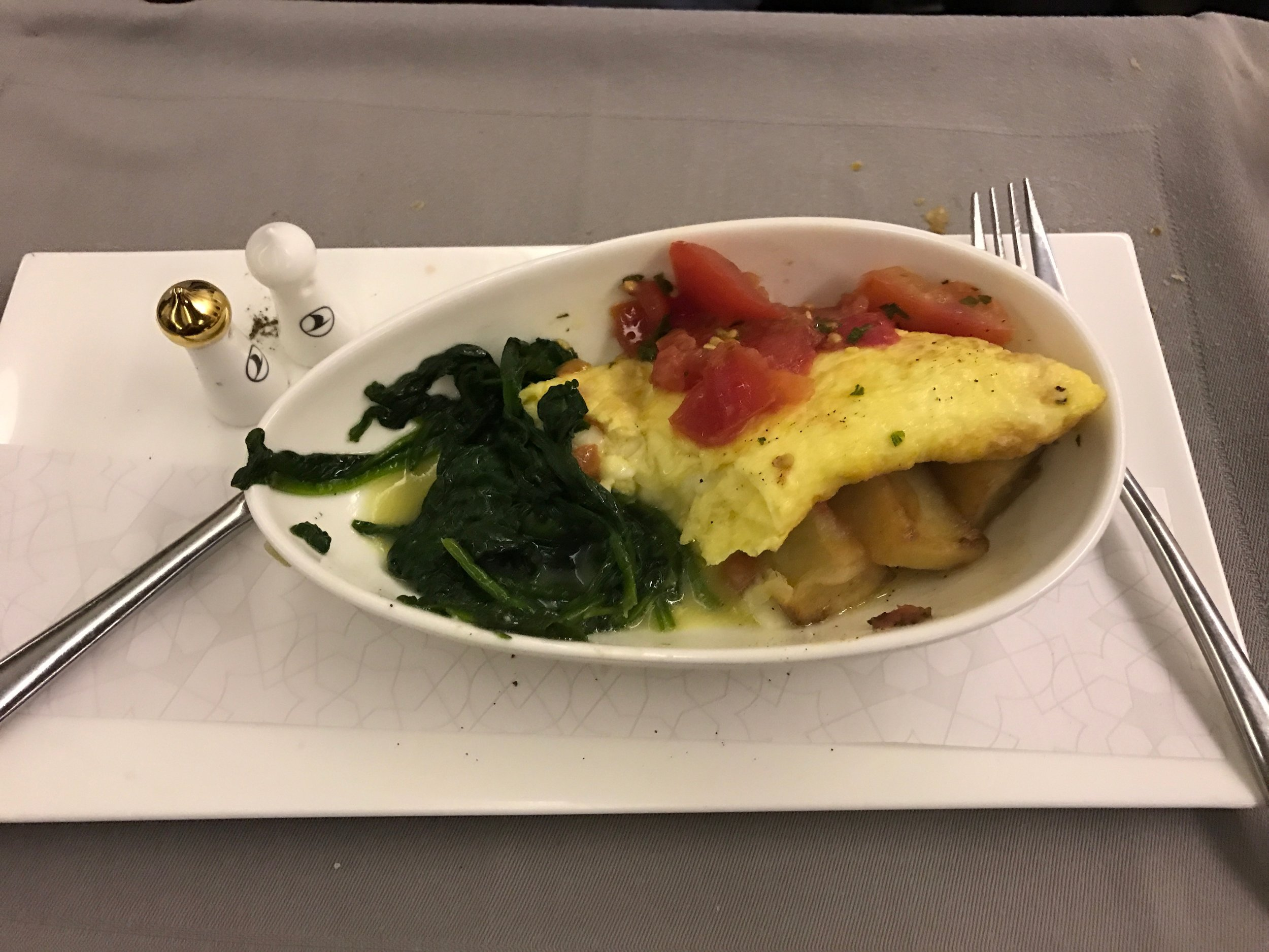 Omlette with potatoes, tomatoes, and spinach