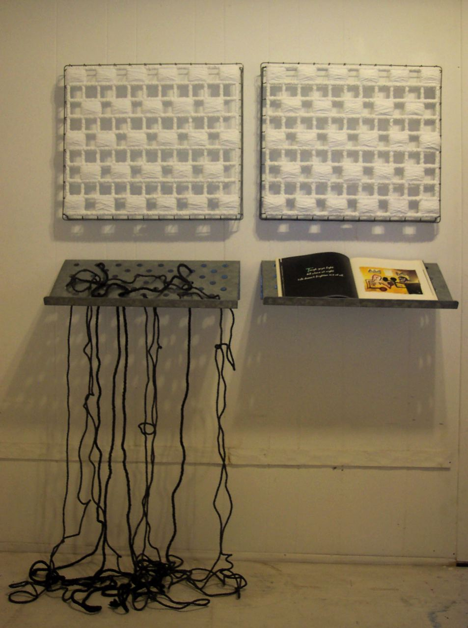Untitled (Life) 2003, Yarn, book (Life Doesn't Frighten Me), aluminum rack, acrylic paint.