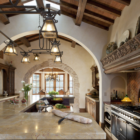 A custom chandelier over the kitchen island.