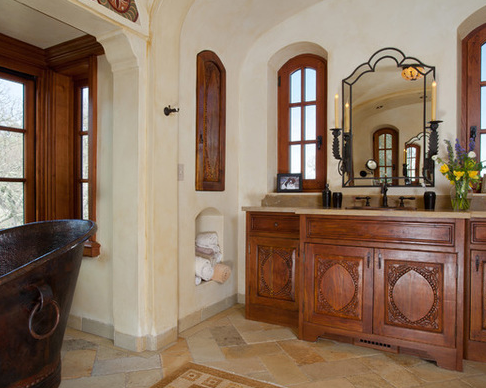 Wrought iron sconces and mirror in the master bath.
