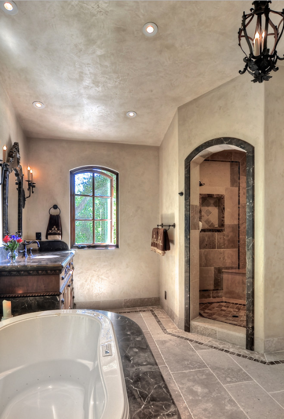 The master bath with Laura Lee Designs lighting.