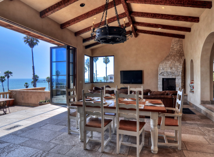 A custom chandelier in the dining area overlooking the ocean.