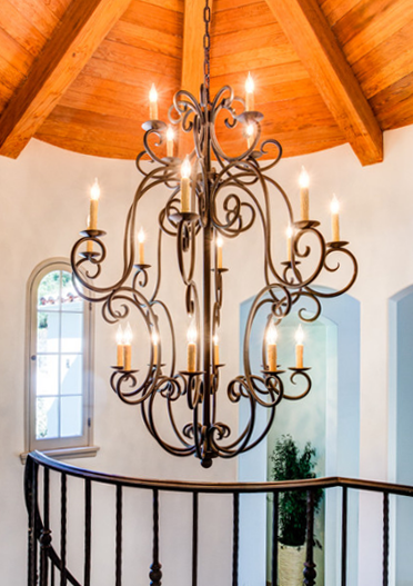 A custom chandelier adorning the stairwell.