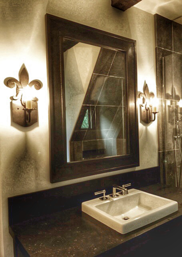 Laura Lee Designs sconces in a transitional bathroom.