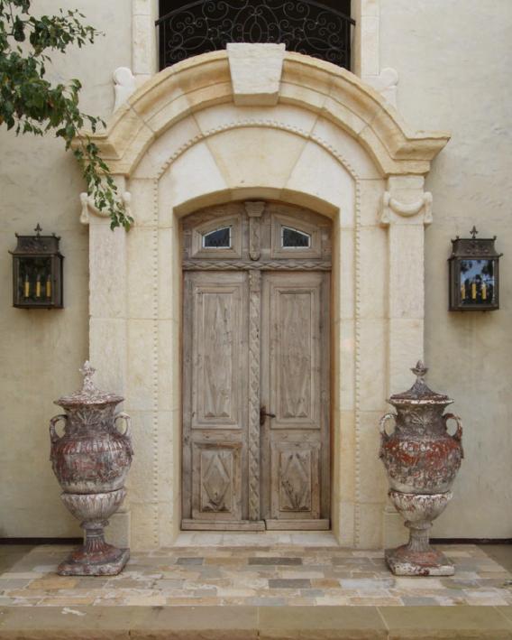 Custom lanterns adorn this Tuscan style home.