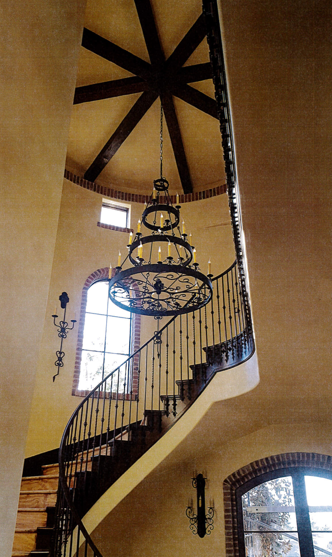 Las Vegas Stairwell with Chandelier and Sconces.jpg