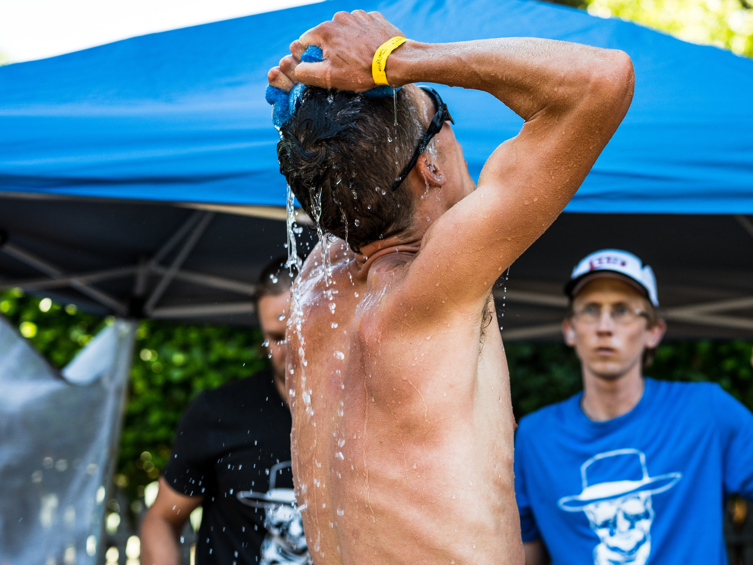 Jim Walmsley_Cooling off at aid station_Ryland West.jpg