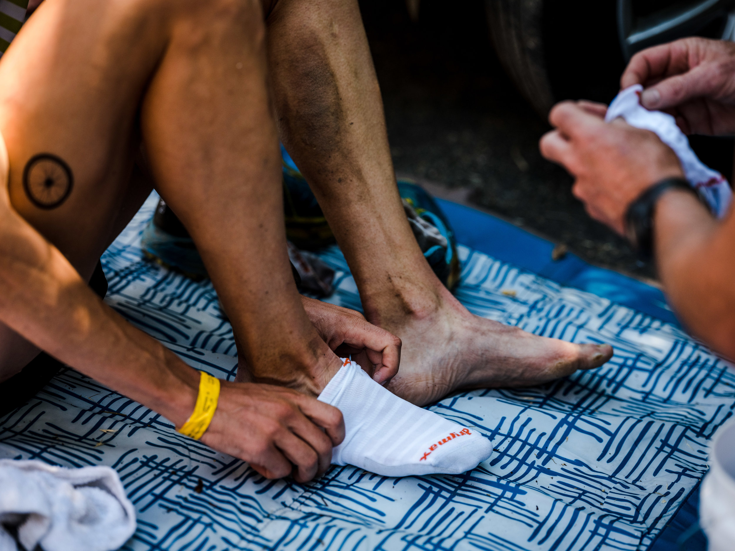 Jim Walmsley_Putting on Sock_Western States_Ryland West.jpg