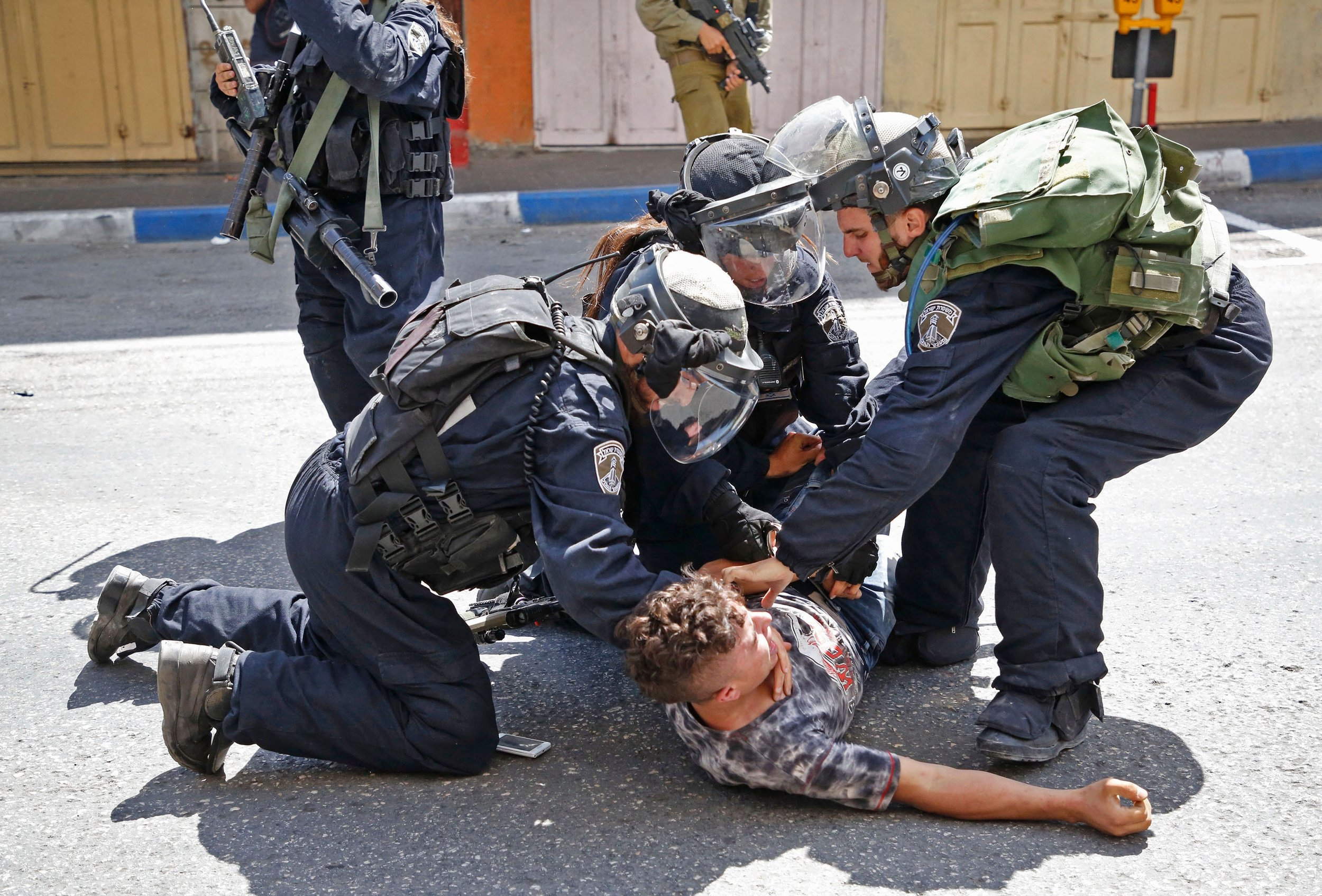 Israeli forces arrest a Palestinian youth during clashes between demonstrators and security forces in the city of Hebron in the Israeli-occupied West Bank, on July 28, 2017. Photo: Hazem Bader/AFP/Getty Images