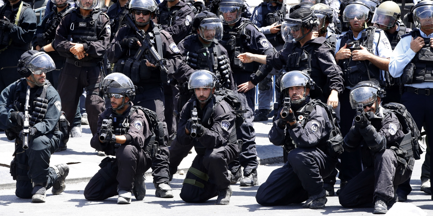 Israeli police forces hold stun-grenade launchers following Friday noon prayer outside Jerusalem's old city on July 28, 2017. Photo: Jack Guez/AFP/Getty Images