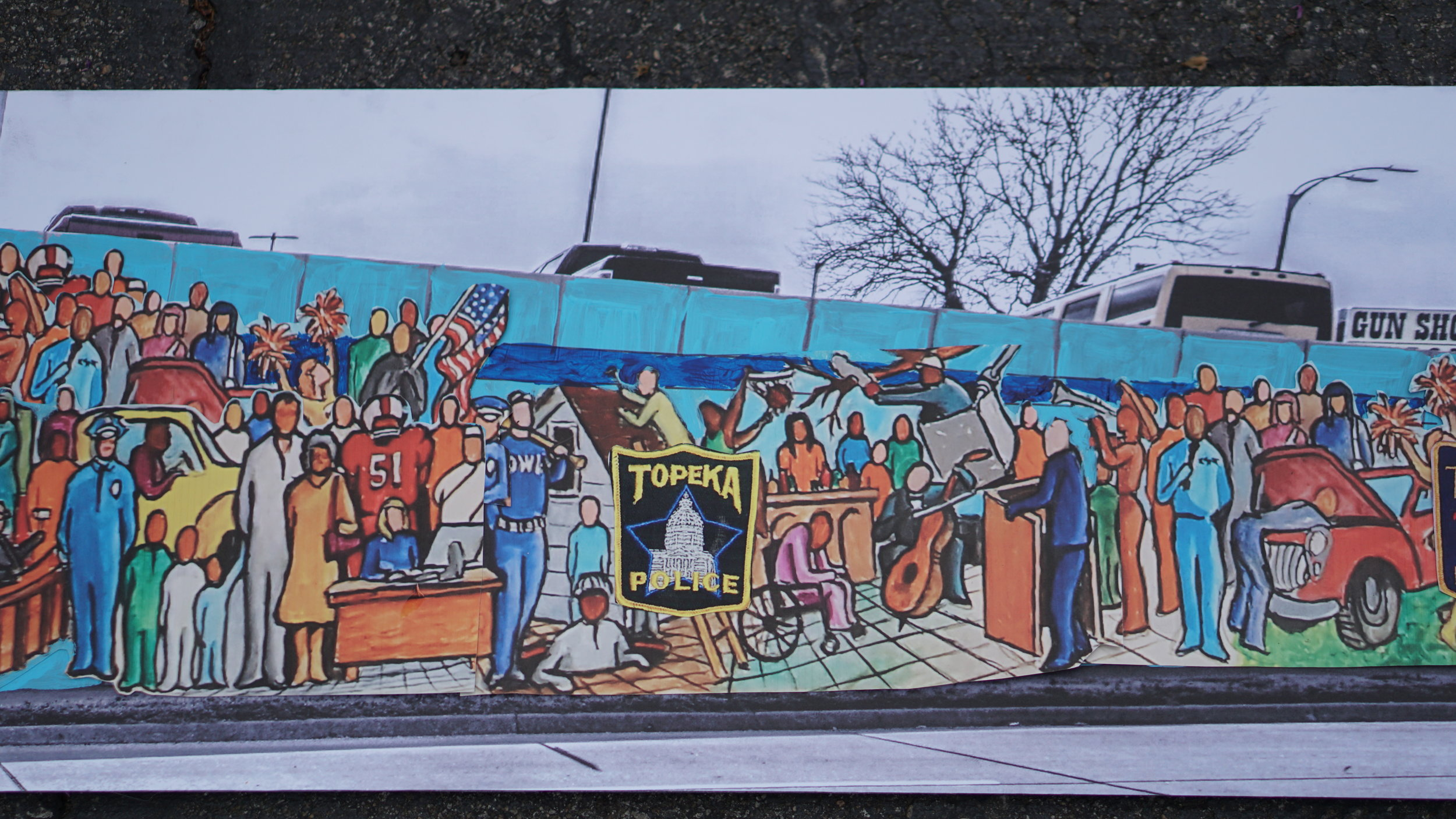 Inspiration for the design of this mural comes from a committee which includes Topeka Police Department staff, community members and a team of local artists. -