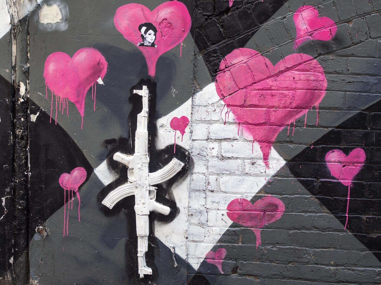 AK47 street art on AC/DC Lane.