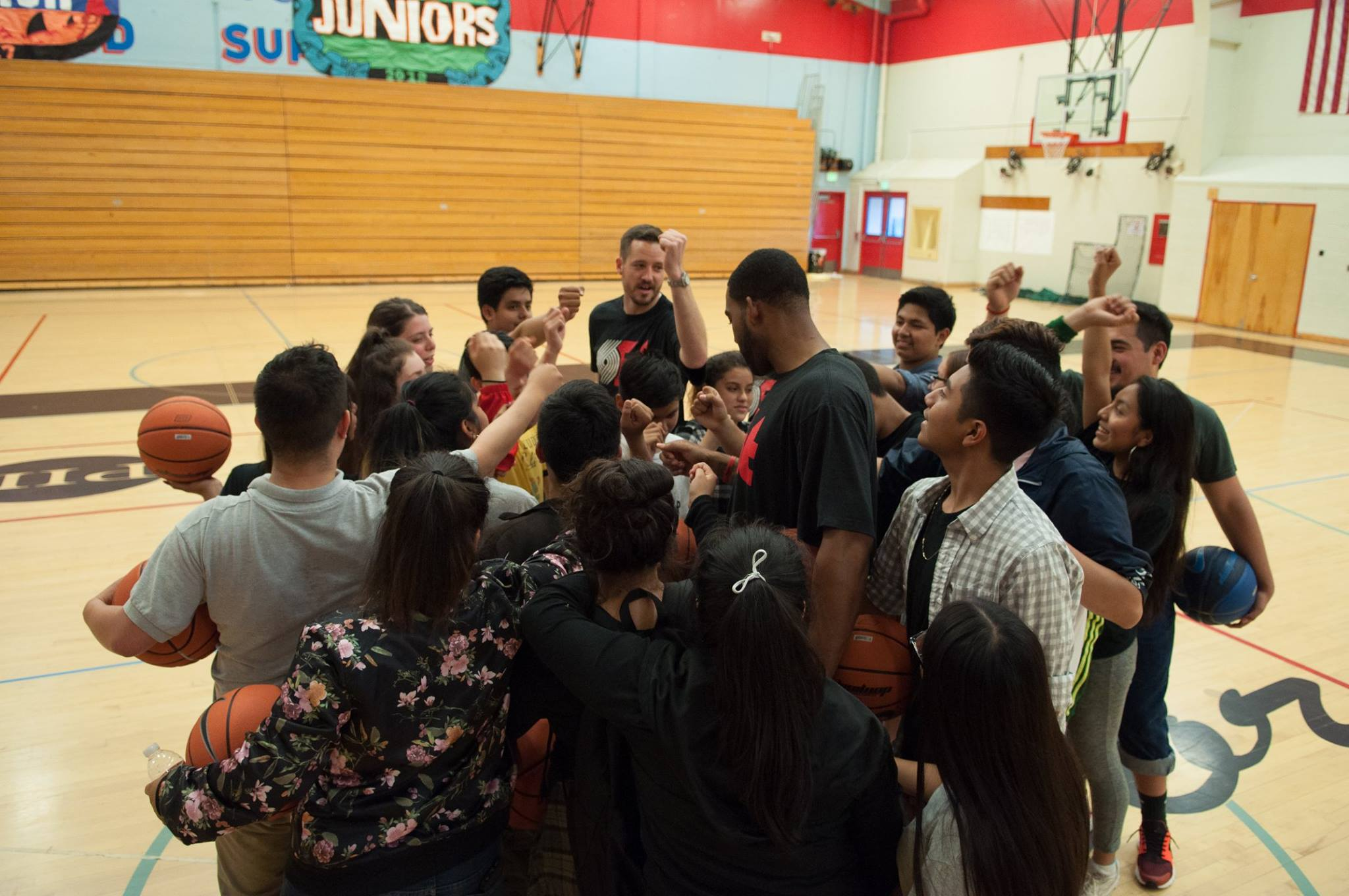 Madison High School Ninth Grade Counts students huddle up after a Portland Trail Blazers basketball clinic.