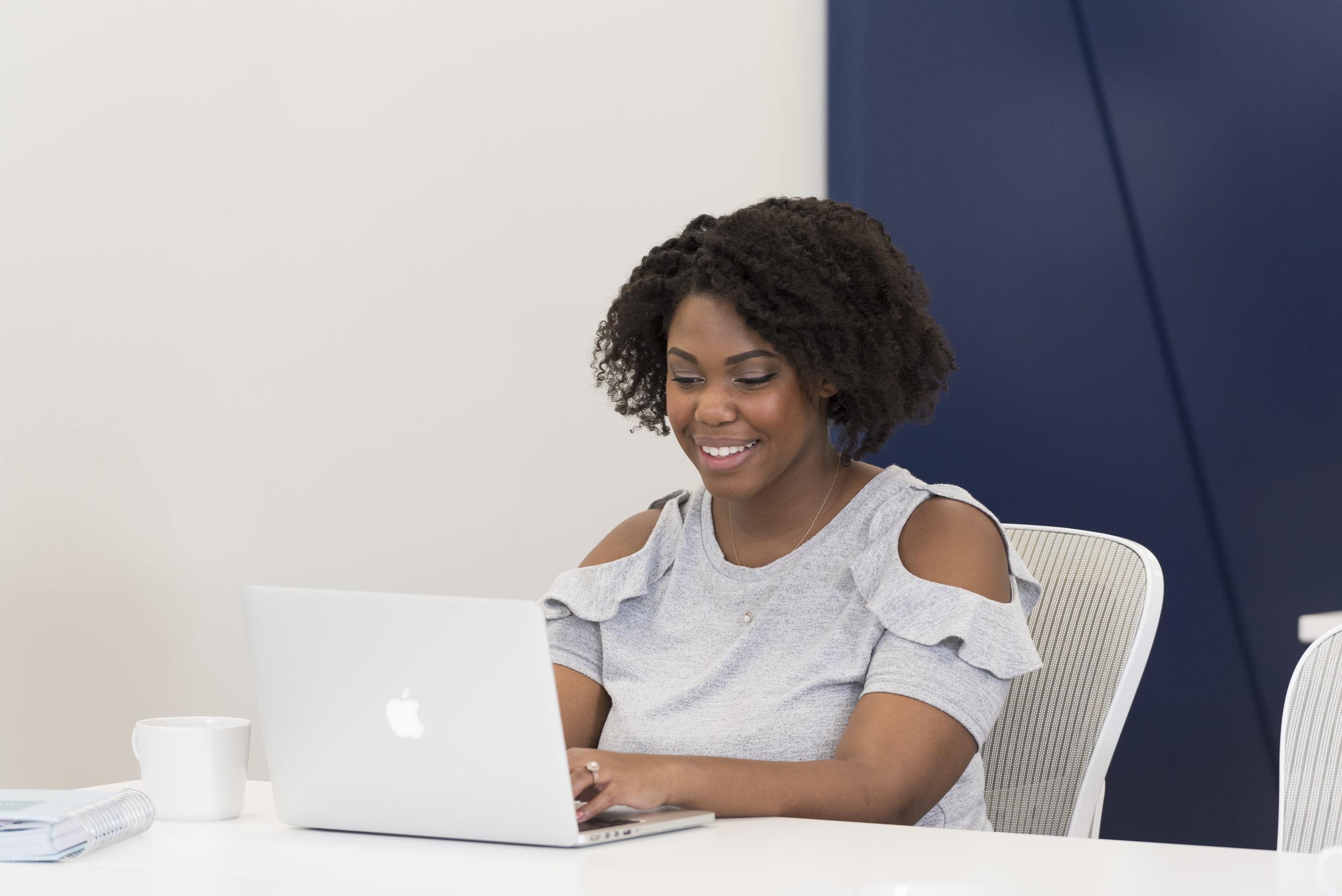 Janelle focused work smile.jpg
