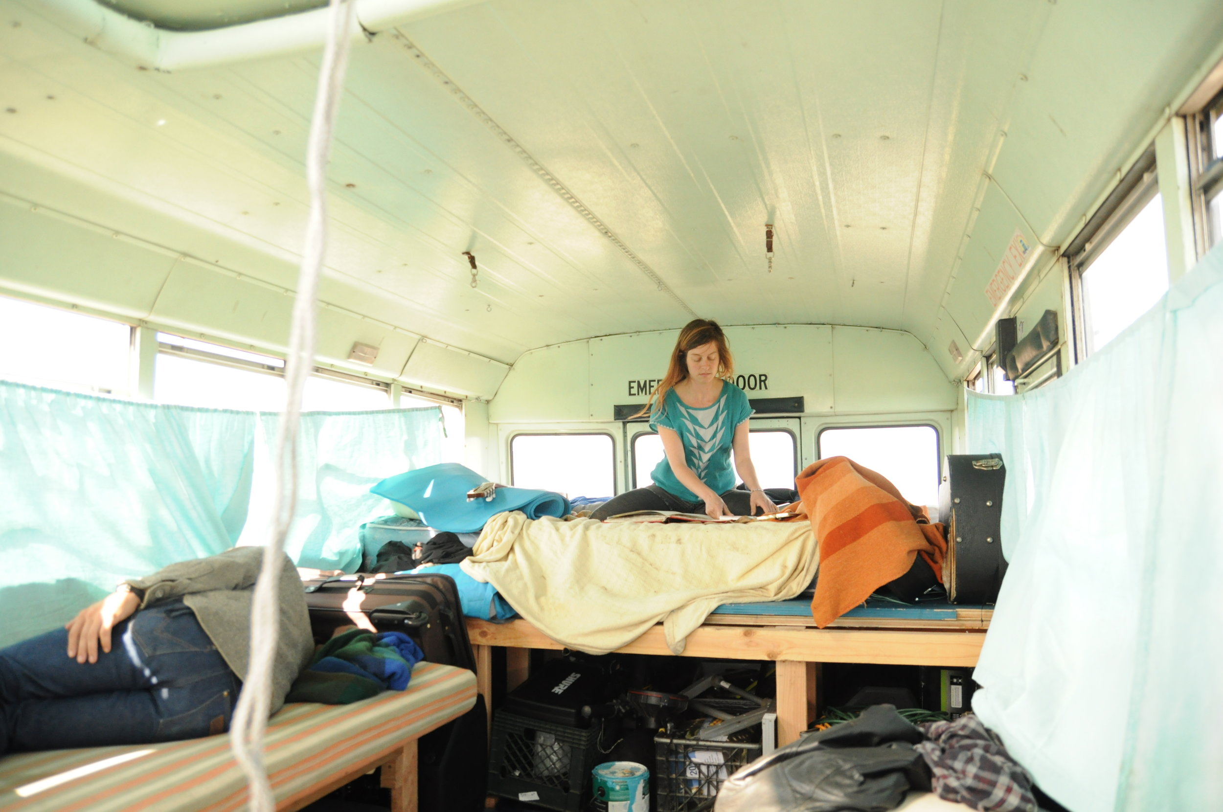 Angela does some art on the impossible back-of-the-bus mattress