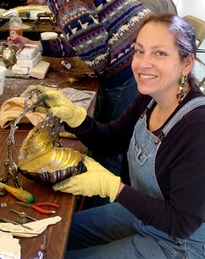 Harriete Estel Berman repairing antique silver.