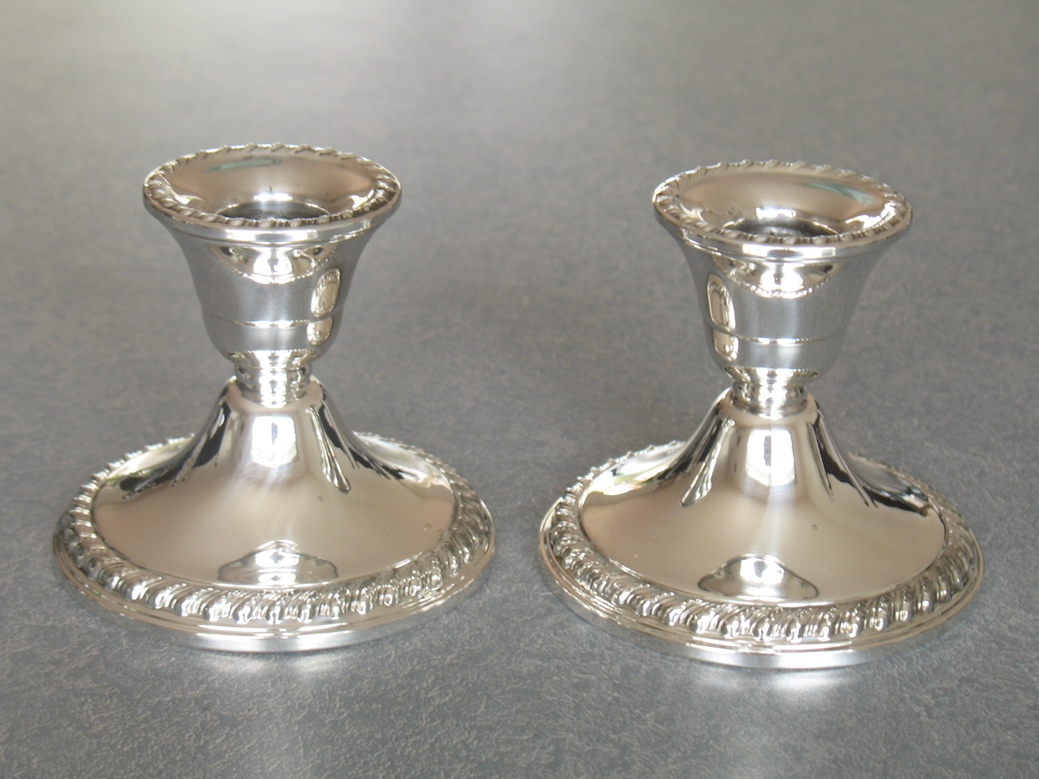 carousel-repaired-sterling-silver-candlesticks .JPG