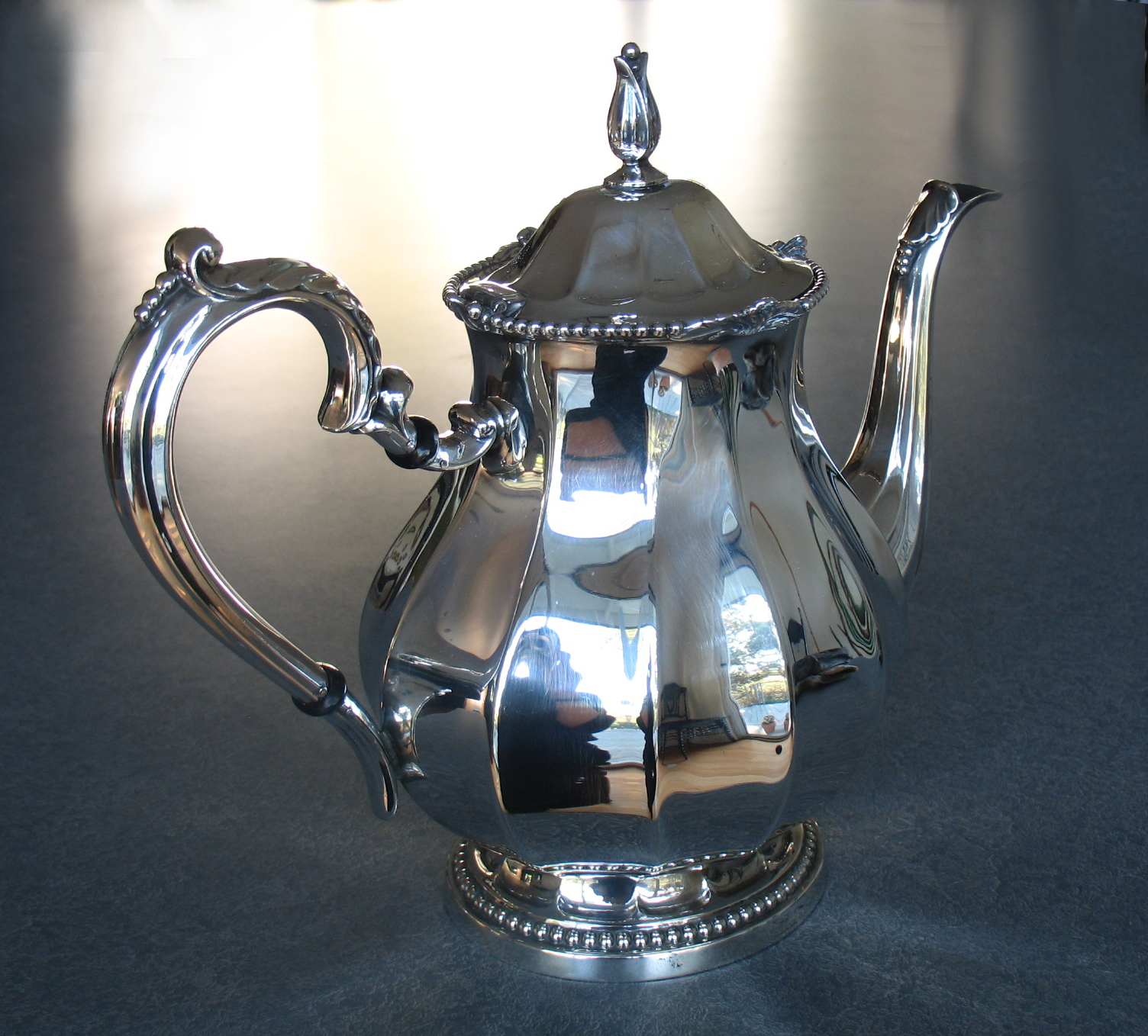 Sterling silver teapot with new hand carved insulators