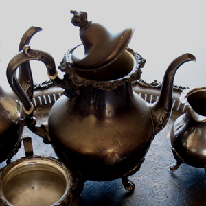 Fire damage silver teapot crushed  BEFORE