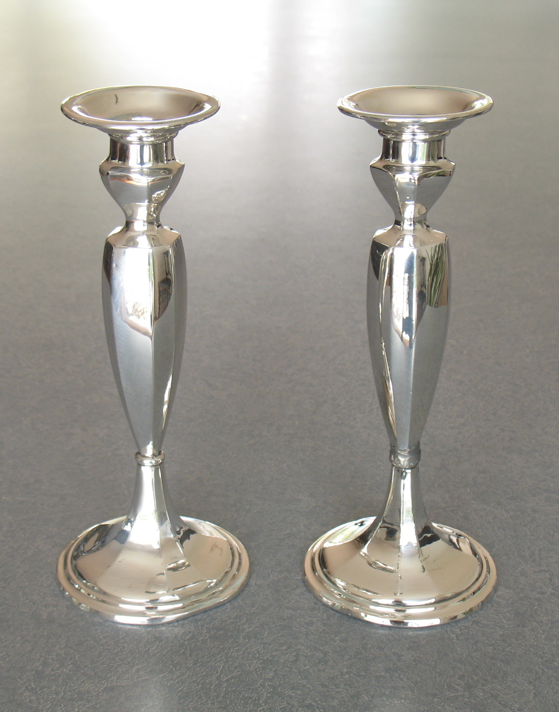 crooked-sterling-silver-candlesticks-repaired-polished.jpg