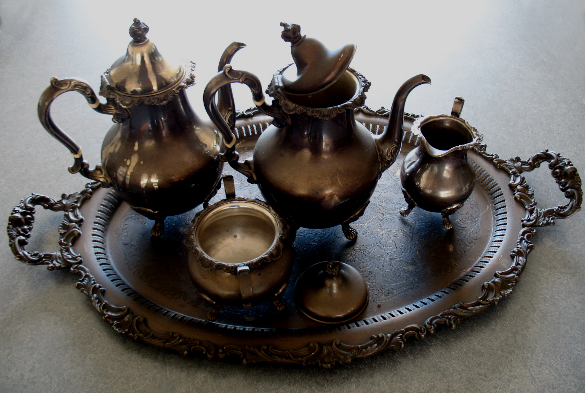 Sterling silver tea and coffee service covered with soot from fire