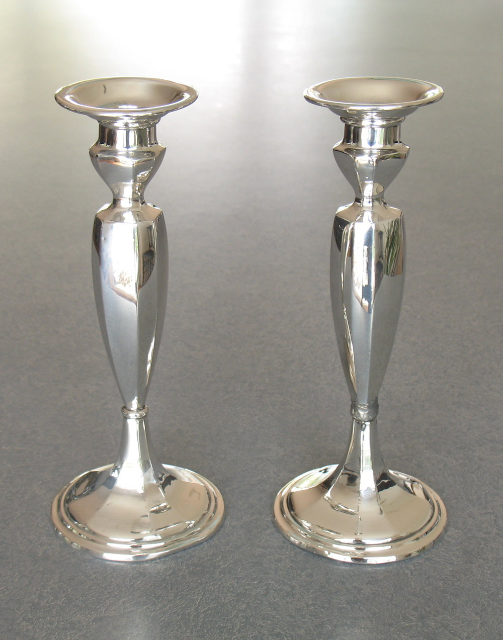 Sterling silver candlestick were crooked and now straightened.