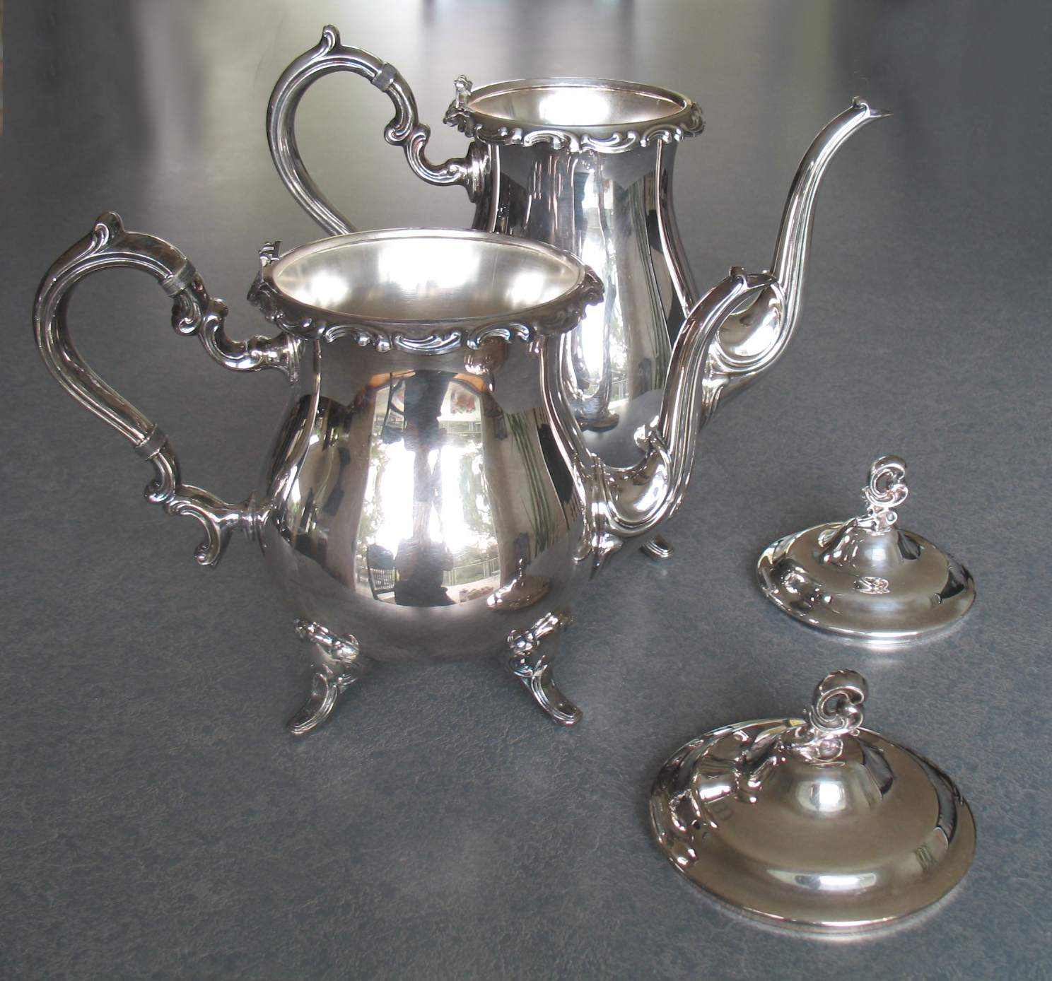 Silverplate coffeepot and teapot with the hinge broken