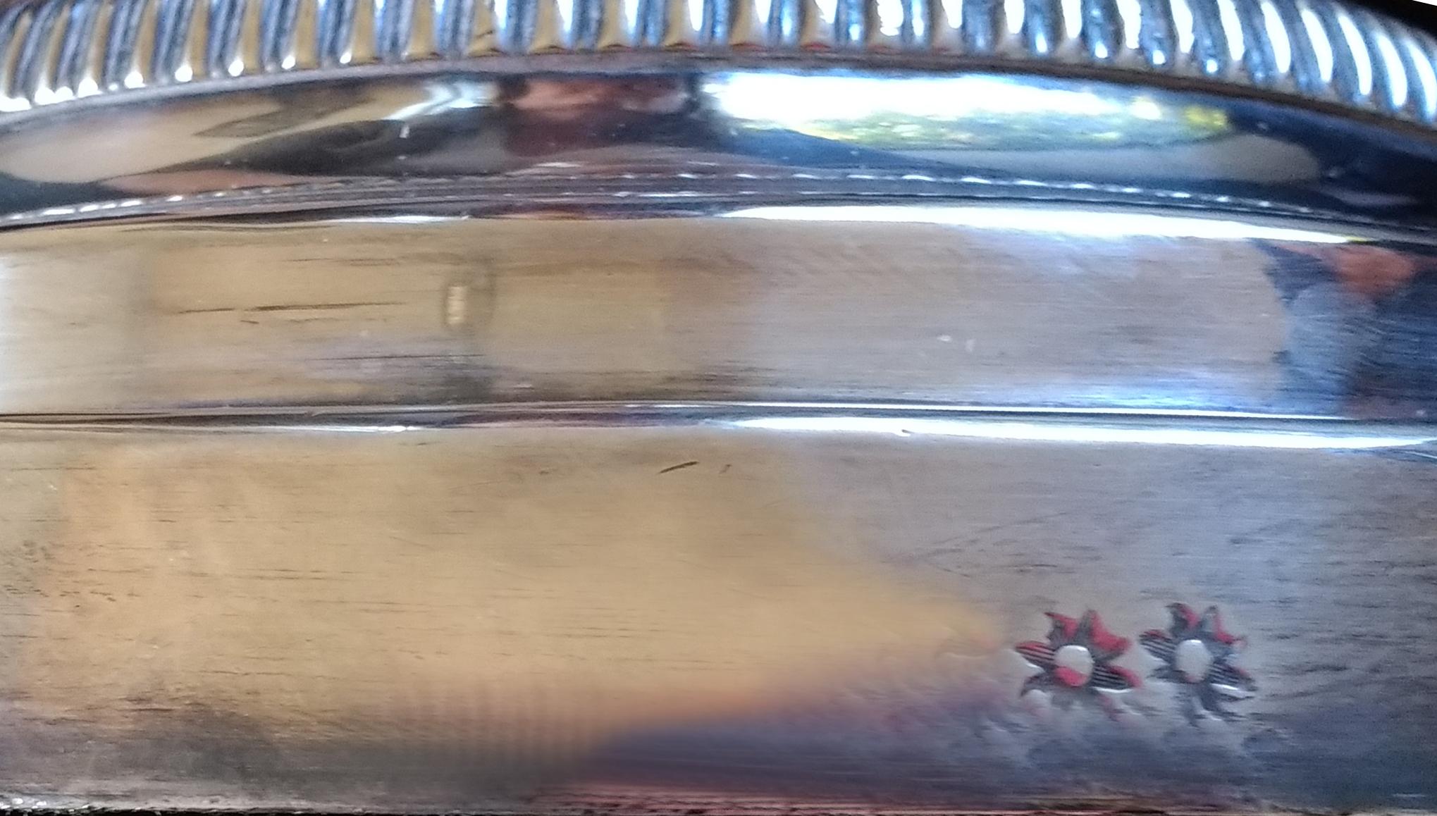 Matthew Boulton maker's mark on a candelabra base.