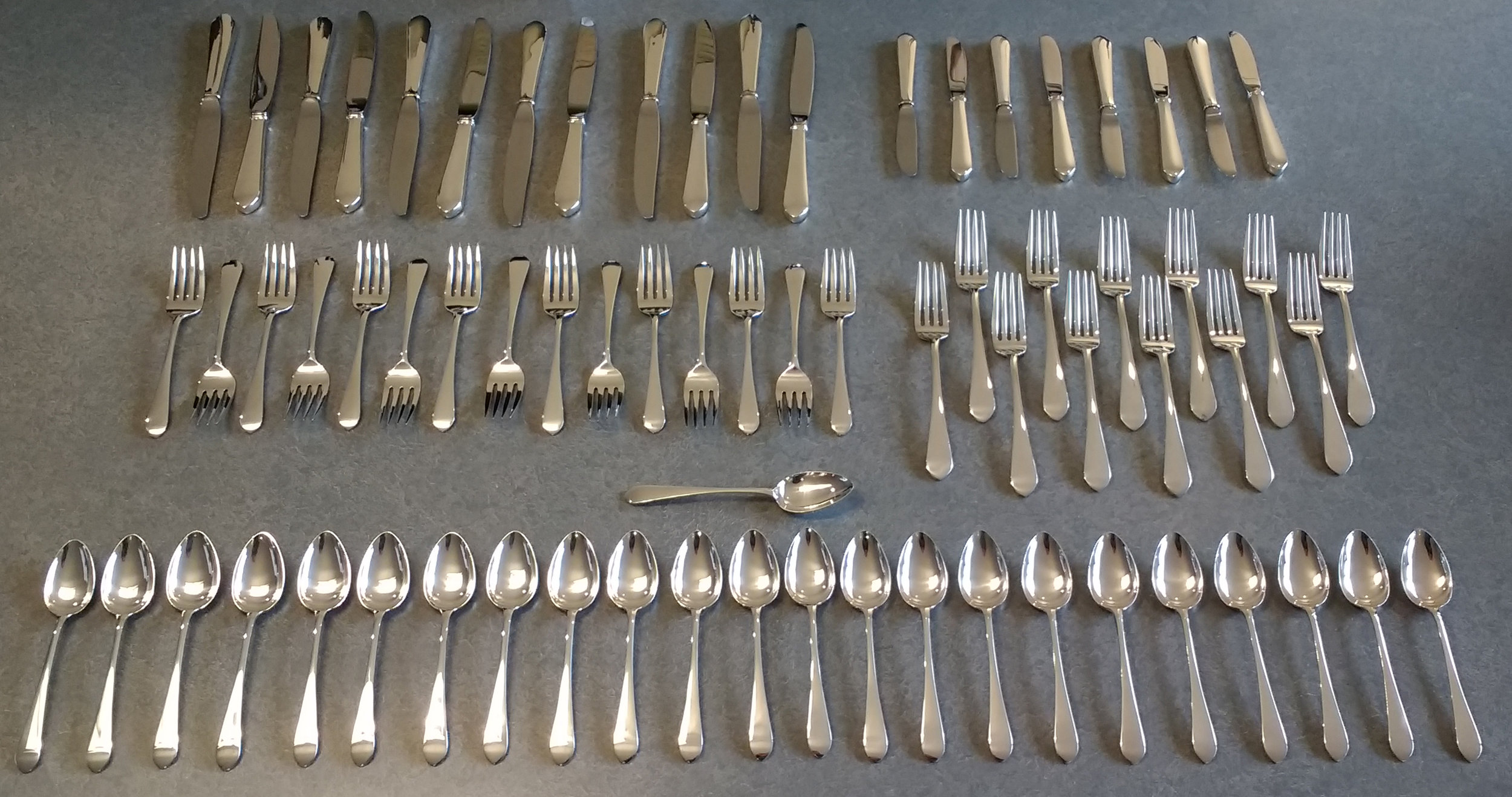 Sterling Silver forks, knives and spoons professionally polished to restore their appearance.