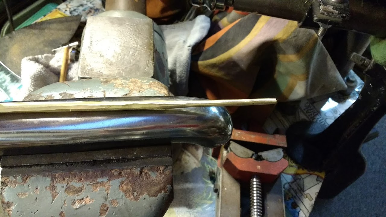Creating a tapered brass rod was the first step.