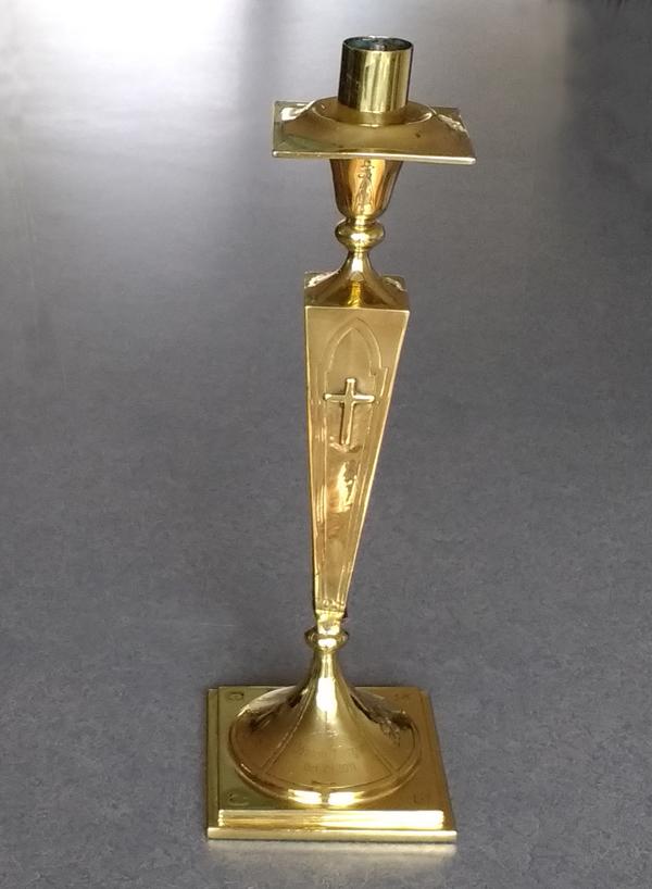 brass candlestick dated 1906 bent