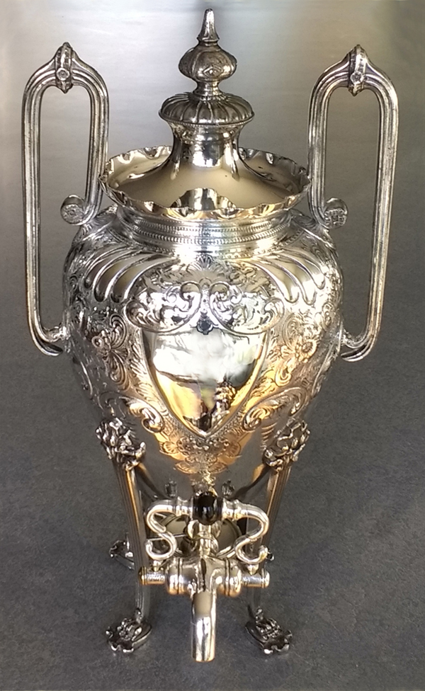 Silverplate urn polished with the spigot repaired