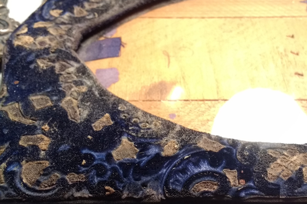 After removing the silver your can see the original plush blue velvet.