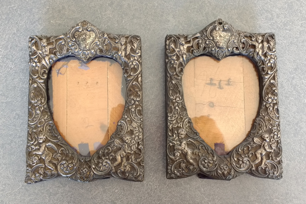 Sterling frames tarnished. The fabric was so dirty and discolored you could not even tell that it was blue velvet.
