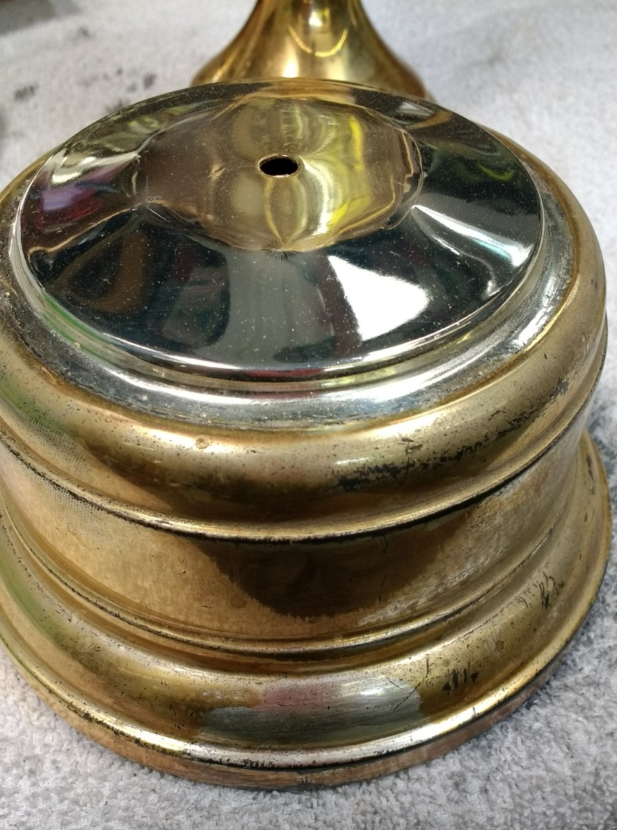 Vintage trophy base was silverplated but the lacquer had changed color.