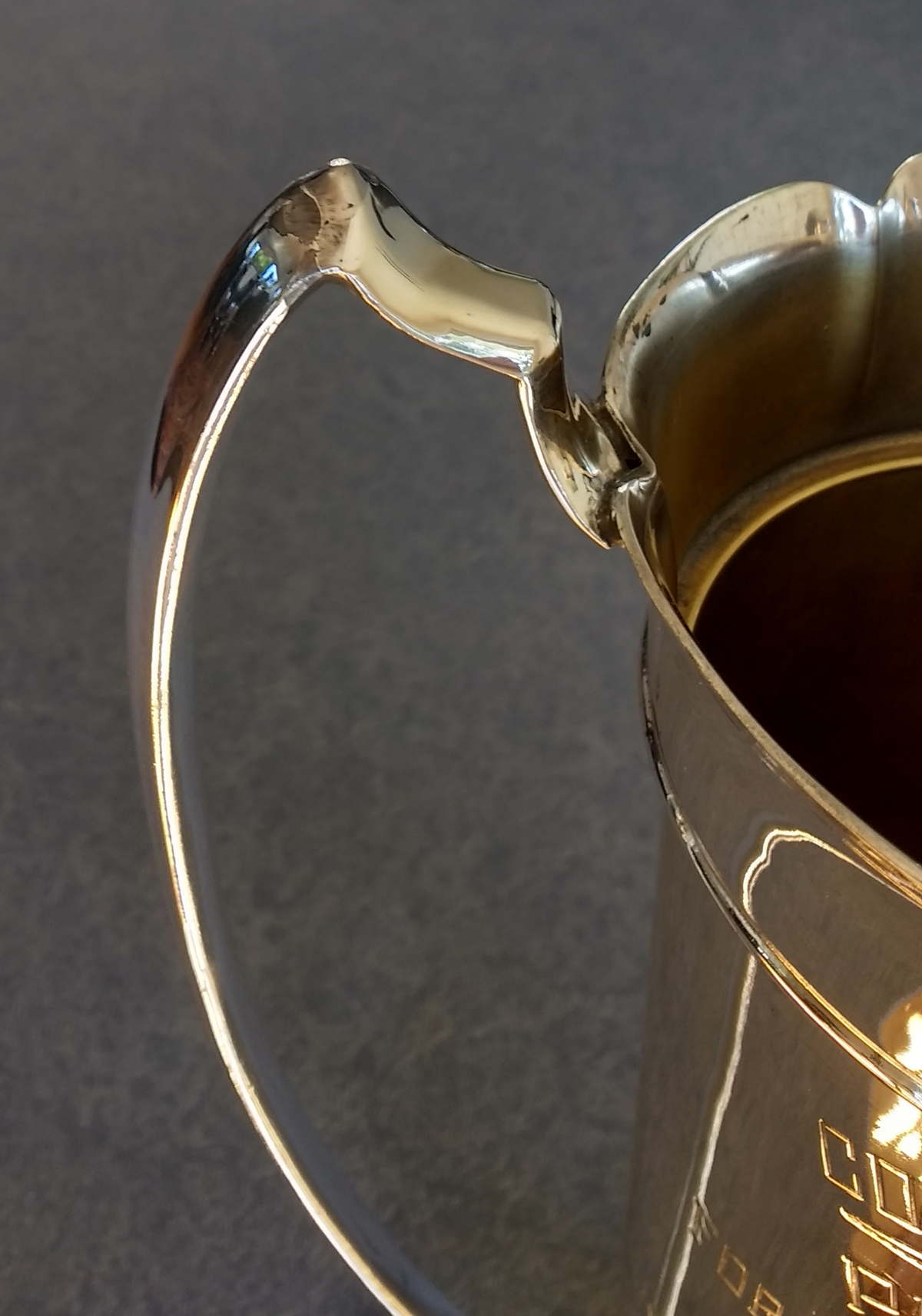 sterling silver carved and fabricated to match the other handle on silverplate trophy