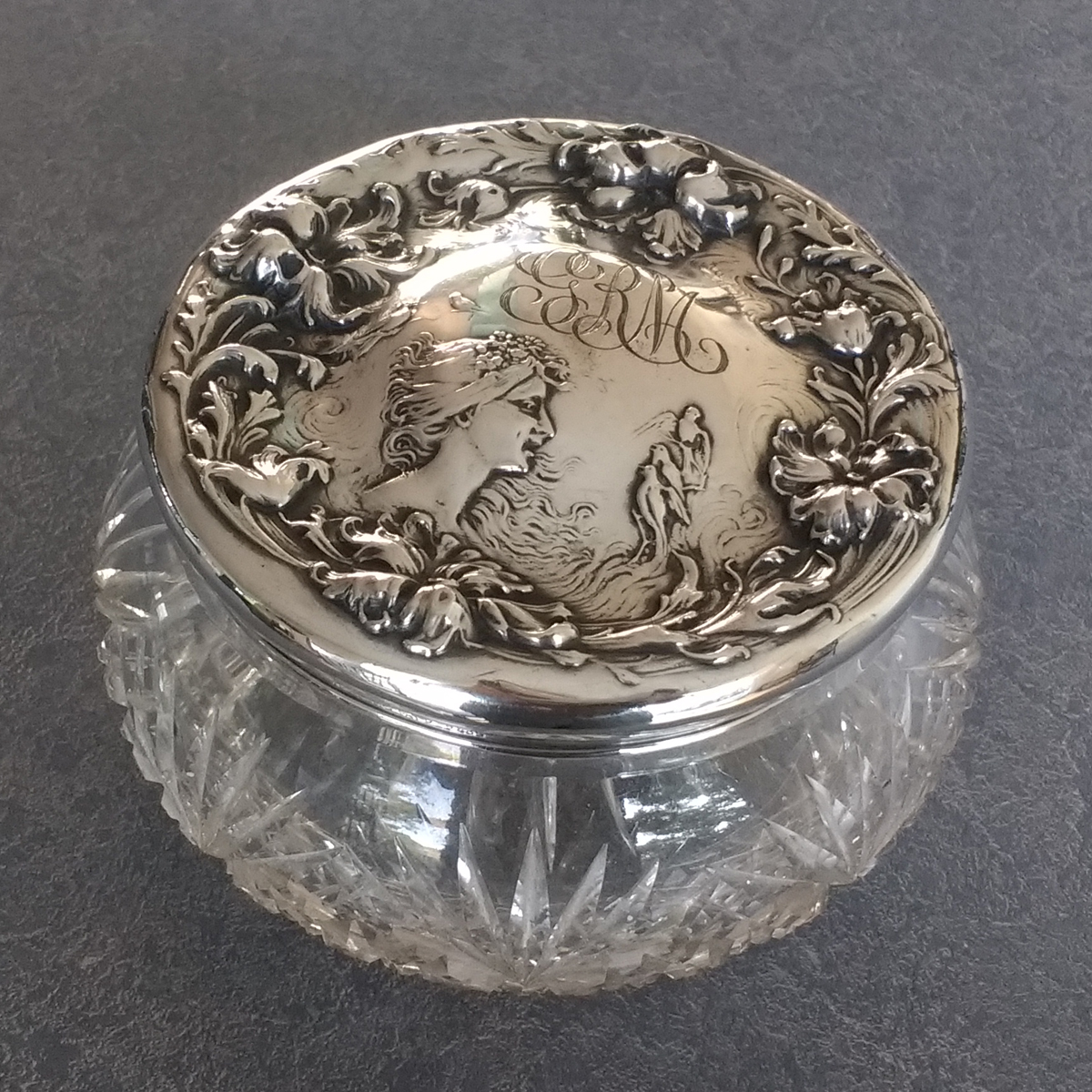 Sterling silver dresser set lid with dents removed
