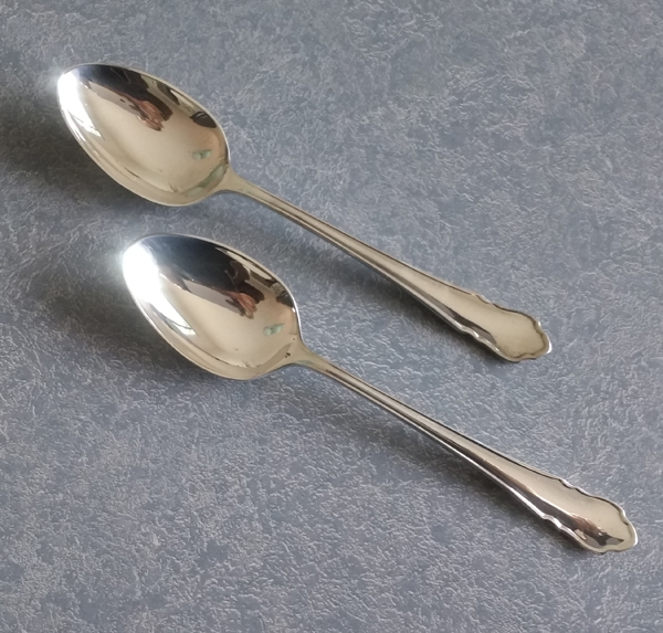 Garbage disposal damaged is repaired for these two sterling silver teaspoons