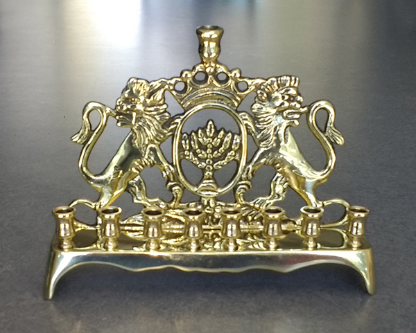 Cash brass menorah with Lion of Judah motif was repaired and polished.