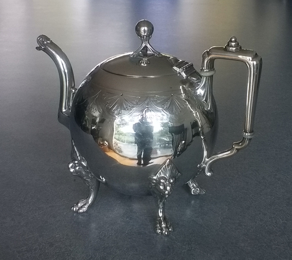 antique 19-century silver plate teapot with dent removed