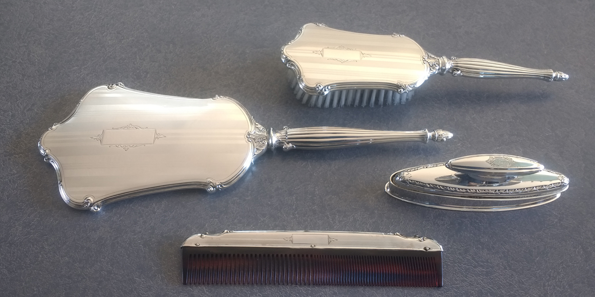 Sterling silver dresser set with mirror, brush, comb and nail buffer
