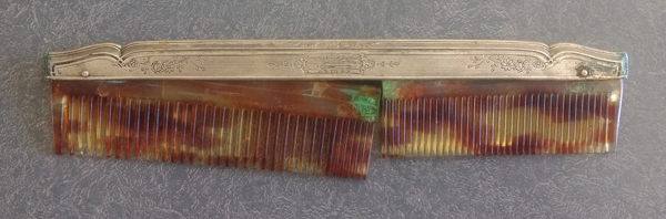 sterling silver fitter with broken comb has green corrosion