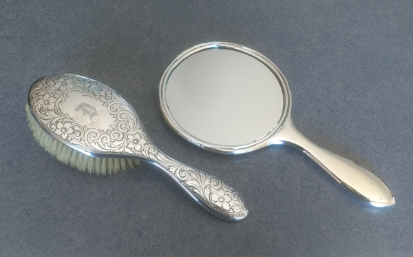 sterling silver hand mirror with new mirror and dents removed.