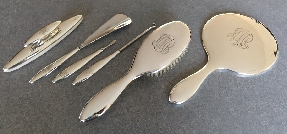 sterling silver dresser set with nail buffer, shoe horn, cuticle knife, button hook, brush, mirror