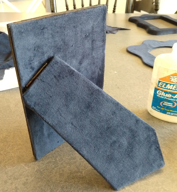 Picture frame easel covered in velvet to match the frame