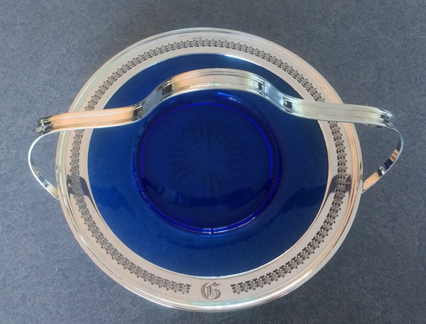 glass plate with sterling silver rim and handle polished