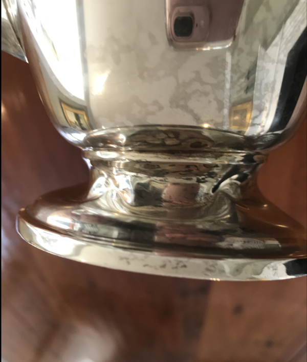 Sterling silver coffeepot with squashed and wrinkled base