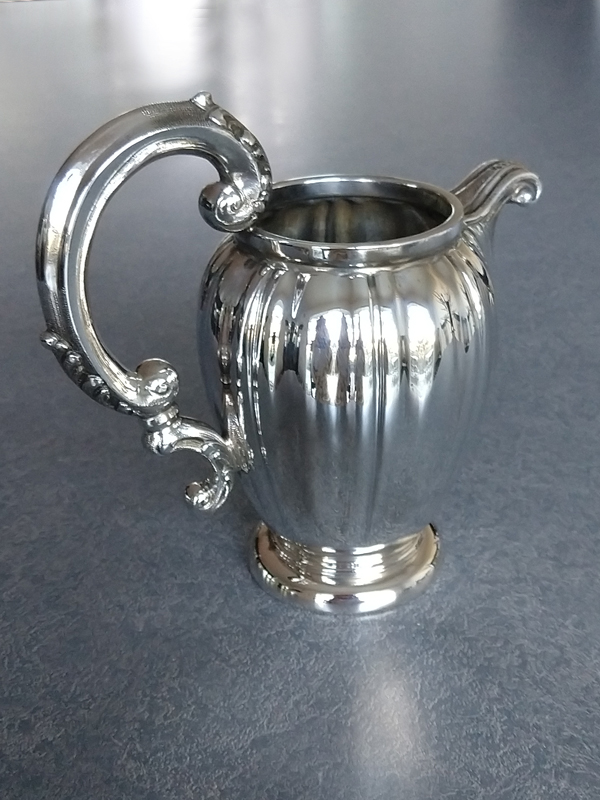 dent removed from sterling silver creamer and polished