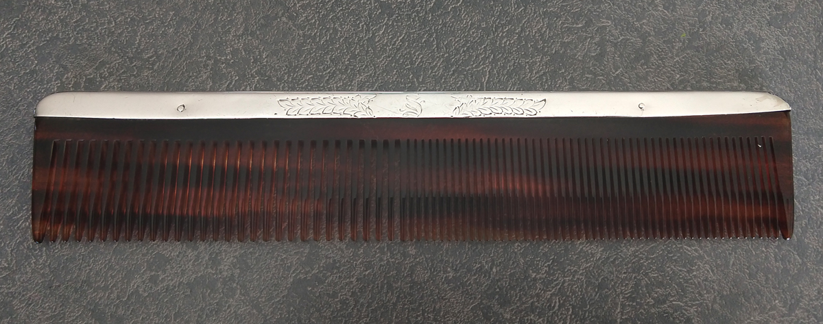 sterling silver comb with ends repaired and new comb